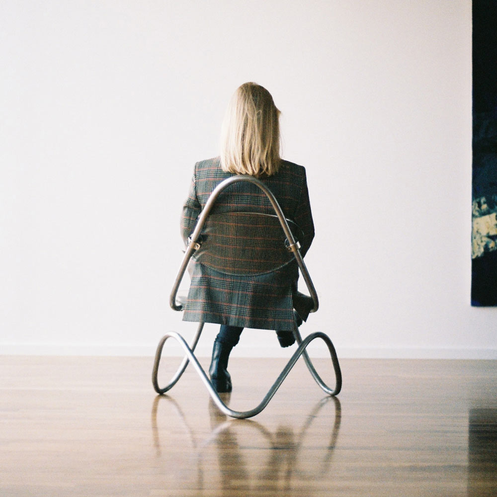 c1-lounge-chair-behind-person